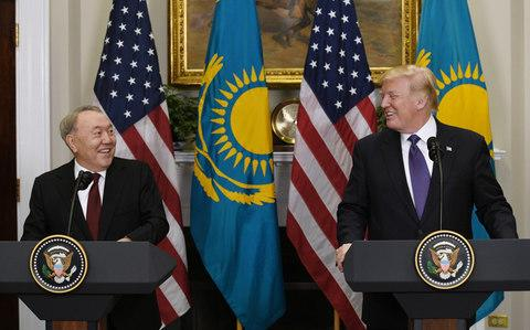 Mr Nazarbayev appears with Donald Trump in the White House on Tuesday. He has tried to balance relations with the United States, Russia and China - Credit: Olivier Douliery/Pool via Bloomberg