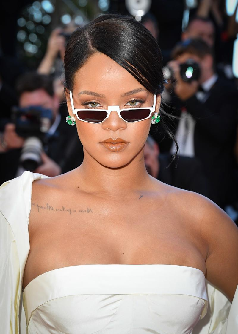 "Rihanna attends the ""Okja"" screening during the 70th annual Cannes Film Festival wearing white sunglasses by Andy Wolf Eyewear."