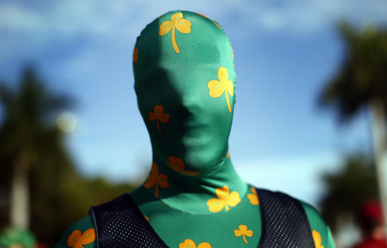 Adam Soisson, a freshman at Notre Dame University, stands dressed in a costume outside Sun Life stadium before the BCS National Championship college football game between the Alabama Crimson Tide and the Notre Dame Fighting Irish in Miami, Florida January 7, 2013.  REUTERS/Mike Segar    (UNITED STATES - Tags: SPORT FOOTBALL TPX IMAGES OF THE DAY)