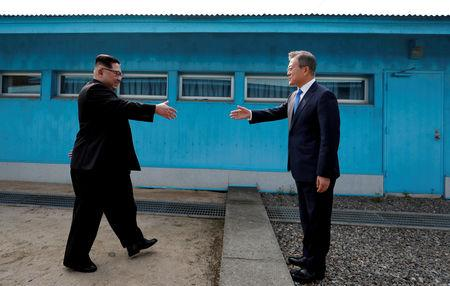 South Korean President Moon Jae-in and North Korean leader Kim Jong Un shake hands at the truce village of Panmunjom inside the demilitarized zone separating the two Koreas, South Korea, April 27, 2018. Korea Summit Press Pool/Pool via Reuters/Files