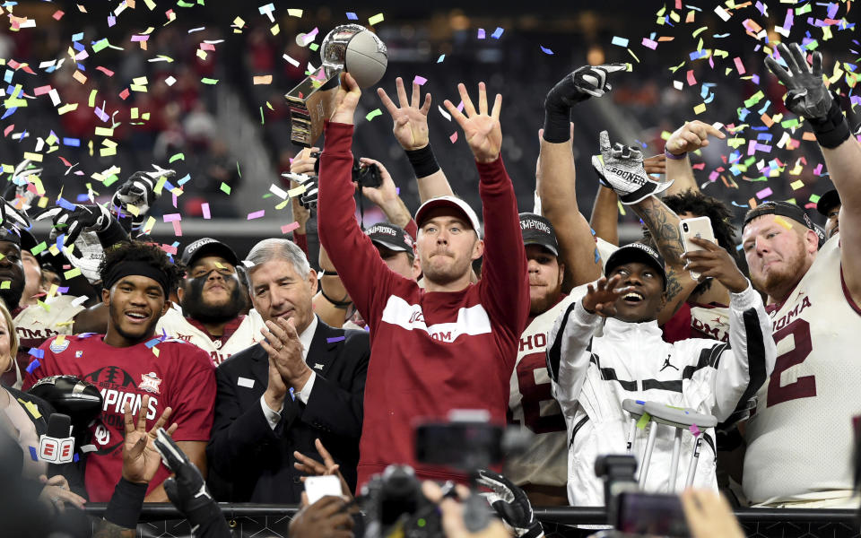 Oklahoma head coach Lincoln Riley hoists the Big 12 Conference championship trophy after beating Texas 39-27 in the Big 12 Conference championship on Saturday, Dec. 1, 2018, in Arlington, Texas. (AP Photo/Jeffrey McWhorter)