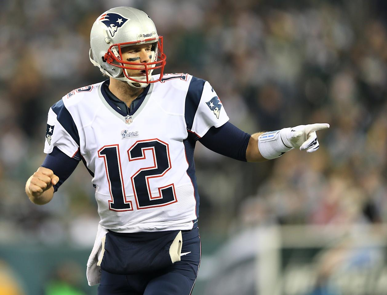 EAST RUTHERFORD, NJ - NOVEMBER 22:   Tom Brady #12 of the New England Patriots celebrates his touchdown pass to Julian Edelman in the second quarter against the New York Jets on November 22, 2012 at MetLife Stadium in East Rutherford, New Jersey.  (Photo by Elsa/Getty Images)
