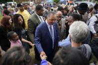 Rev. Jesse Jackson meets people after the dedication of a prayer wall outside of the historic Vernon African Methodist Episcopal Church in the Greenwood neighborhood during the centennial of the Tulsa Race Massacre, Monday, May 31, 2021, in Tulsa, Okla. The church was largely destroyed when a white mob descended on the prosperous Black neighborhood in 1921, burning, killing, looting and leveling a 35-square-block area. (AP Photo/John Locher)