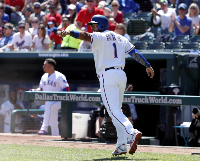 Texas Rangers' Elvis Andrus celebrates after stealing home during a Logan Forsythe at-bat in the first inning of a baseball game against the Oakland Athletics in Arlington, Texas, Sunday, April 14, 2019. (AP Photo/Tony Gutierrez)