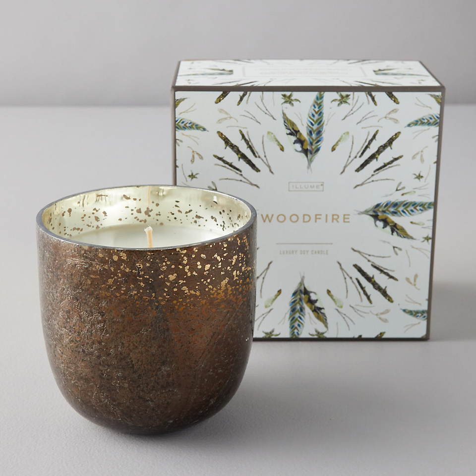 """<h3>Terrain Woodfire Candle</h3><br>As one reviewer claims, this soy wax infused with notes of patchouli and warm vanilla really """"does smell like a burning campfire.""""<br><br><strong>Illume</strong> Mercury Glass Candle, Woodfire, $, available at <a href=""""https://go.skimresources.com/?id=30283X879131&url=https%3A%2F%2Fwww.shopterrain.com%2Fproducts%2Fillume-mercury-glass-candle-woodfire"""" rel=""""nofollow noopener"""" target=""""_blank"""" data-ylk=""""slk:Terrain"""" class=""""link rapid-noclick-resp"""">Terrain</a>"""
