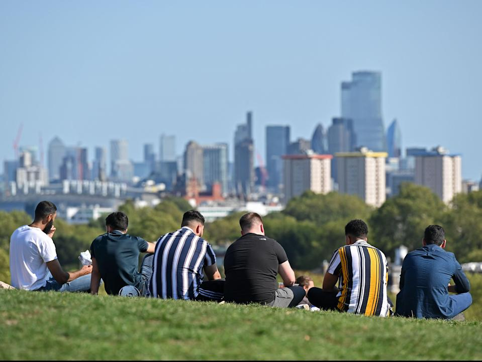 People gather on Primrose Hill on the last day before the new restrictions come into force (AFP via Getty Images)
