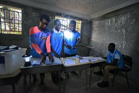 Electoral workers count the votes during a presidential run-off in Freetown, Sierra Leone March 31, 2018. REUTERS/Olivia Acland
