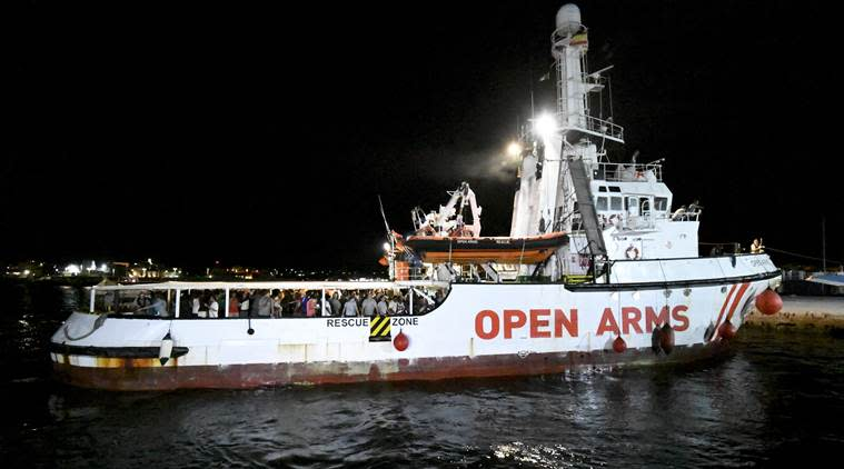 Migrants exit rescue ship Italy, italy migrant ship, open arms, world news