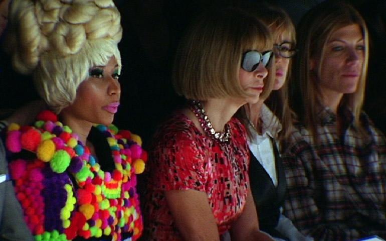 This image from video made on Monday, Sept. 12, 2011, shows Vogue editor in chief Anna Wintour, second from left, and recording artist Nicki Minaj, left, at the Carolina Herrera Spring 2012 presentation during Fashion Week in New York.    (AP Photo/APTV)