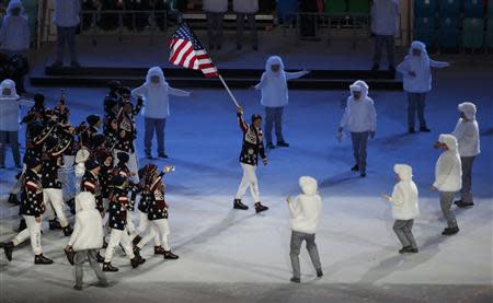 Flag-bearer Todd Lodwick of the U.S. leads his country's contingent during the opening ceremony of the 2014 Sochi Winter Olympics, February 7, 2014. REUTERS/Lucy Nicholson