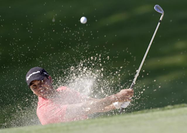 Jason Day, of Australia, hits out of a bunker on the 18th hole during the first round of the Memorial golf tournament Thursday, May 29, 2014, in Dublin, Ohio. (AP Photo/Jay LaPrete)