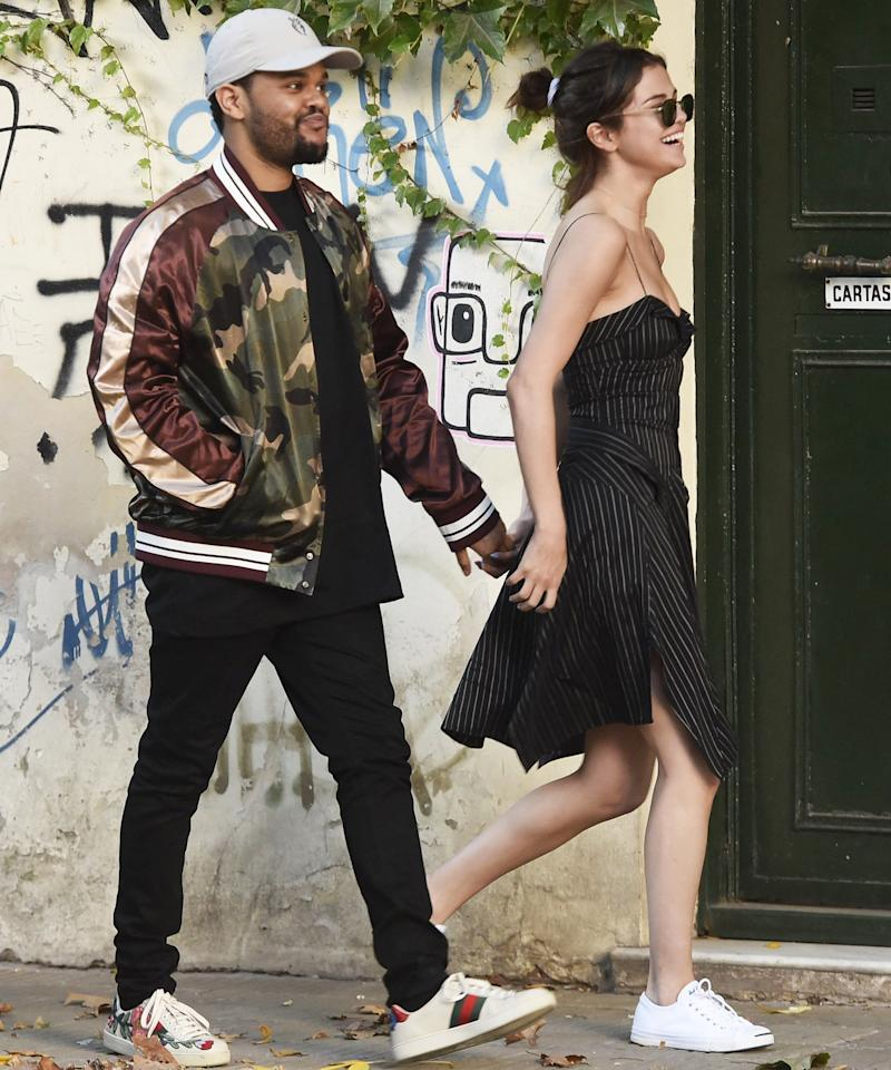 """<p>Gomez looked effortlessly cool while <a rel=""""nofollow"""" href=""""http://www.instyle.com/news/selena-gomez-the-weeknd-pda-buenos-aires"""">strolling through Buenos Aires</a> with her boyfriend, The Weeknd, in a black striped Isabel Marant dress ($1,350; available in beige at <a rel=""""nofollow"""" href=""""https://click.linksynergy.com/fs-bin/click?id=93xLBvPhAeE&subid=0&offerid=279716.1&type=10&tmpid=5459&RD_PARM1=http%253A%252F%252Fwww.bergdorfgoodman.com%252FIsabel-Marant-SHAPER%252Fprod126470209%252Fp.prod&u1=ISNEWSSelenaGomezDress3.29OB"""">bergdorfgoodman.com</a>), white Converse Jack Purcell sneakers ($65; <a rel=""""nofollow"""" href=""""http://shop.nordstrom.com/s/converse-jack-purcell-sneaker-men/2896314?origin=category-personalizedsort&fashioncolor=WHITE"""">nordstrom.com</a>), and round sunglasses. <em>For a similar strappy black patterned sundress, try <a rel=""""nofollow"""" href=""""http://us.topshop.com/en/tsus/product/clothing-70483/dresses-70497/patchwork-belted-slip-dress-6343631?bi=20&ps=20"""">this look via Topshop</a> ($75).</em></p>"""