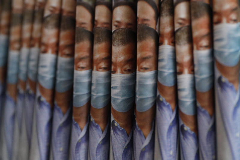 Copies of Apple Daily newspaper with front pages featuring Hong Kong media tycoon Jimmy Lai, are displayed for sale at a newsstand in Hong Kong, Tuesday, Aug. 11, 2020. Hong Kong police have arrested Lai and raided the publisher's headquarters, broadening their enforcement of a new security law and raising fears about press freedom in the semi-autonomous Chinese city. (AP Photo/Kin Cheung)
