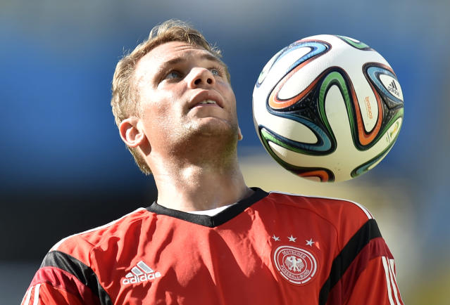 Germany's goalkeeper Manuel Neuer exercises during an official training session one day before the World Cup quarterfinal soccer match between Germany and France at the Maracana Stadium in Rio de Janeiro, Brazil, Thursday, July 3, 2014. (AP Photo/Martin Meissner)