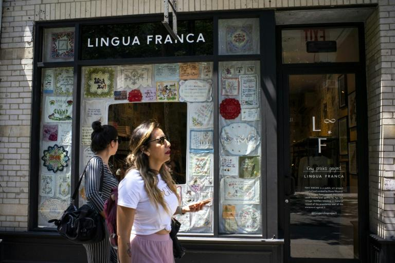 """Diana Weymar's project to embroider US President Donald Trump's most outlandish statements, seen outside the Lingua Franca store in New York, began in 2018 when she stitched """"I am a very stable genius"""" onto a cloth (AFP Photo/EDUARDO MUNOZ ALVAREZ)"""