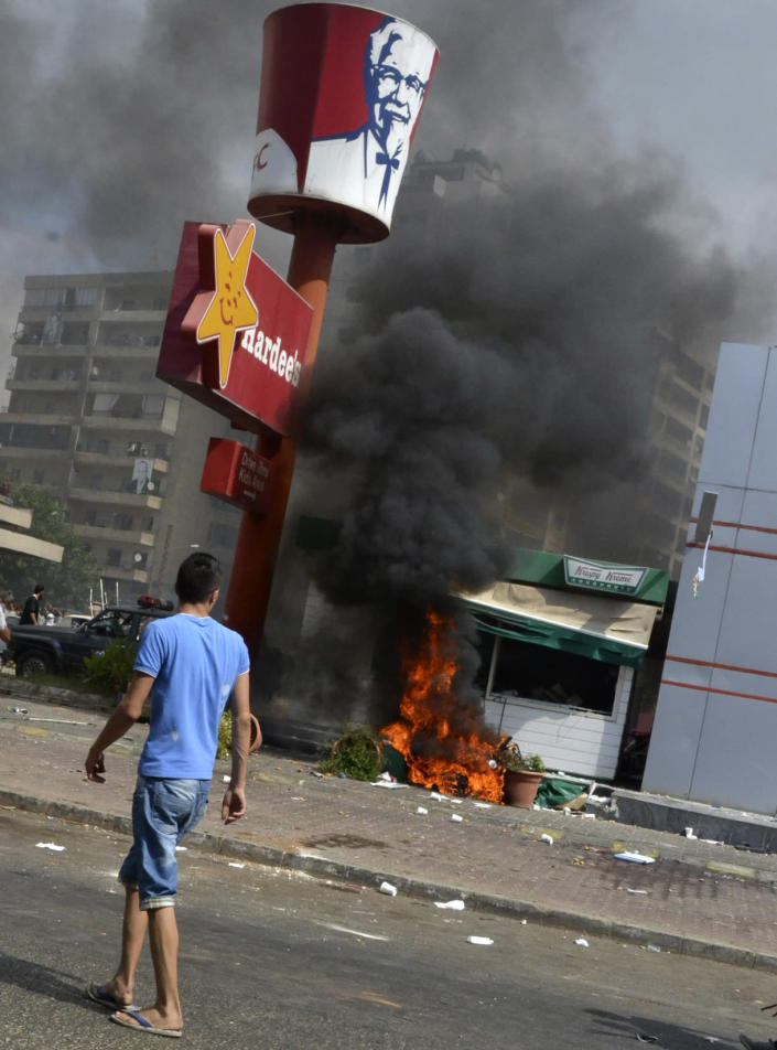 Lebanese protesters attacked American fast food restaurants after Friday prayers, pouring petrol on the restaurants and setting them on fire in the northeastern city of Tripoli, Lebanon, Friday Sept. 14, 2012. According to security officials no one was hurt in the attack which is part of widespread anger across the Muslim world about a film ridiculing Islam's Prophet Muhammad. (AP Photo)