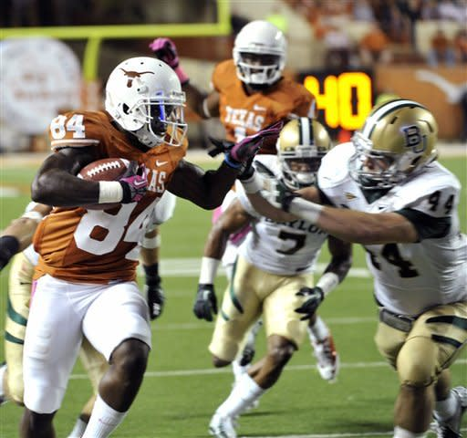 Texas receiver Marquise Goodwin (84) runs against Baylor linebacker Bryce Hagar (44) in the first quarter of an NCAA college football game on Saturday, Oct. 20, 2012, in Austin, Texas. (AP Photo/Michael Thomas)