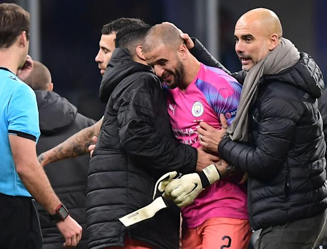 Guardiola congratulates Walker for his keeping performance (Photo by MIGUEL MEDINA/AFP via Getty Images)
