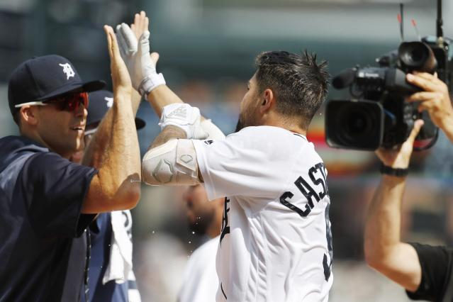 Detroit Tigers designated hitter Nicholas Castellanos is congratulated by teammates after his walk off solo home run during the tenth inning of a baseball game against the Toronto Blue Jays, Sunday, July 21, 2019, in Detroit. (AP Photo/Carlos Osorio)