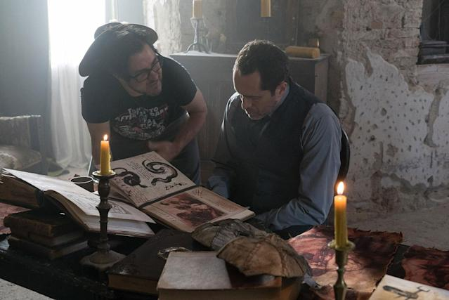 (L-R) Director Corin Hardy and Demian Bichir on the set of New Line Cinema's horror film <i>The Nun</i> a Warner Bros. Pictures release. (© 2018 WARNER BROS. ENTERTAINMENT INC.)