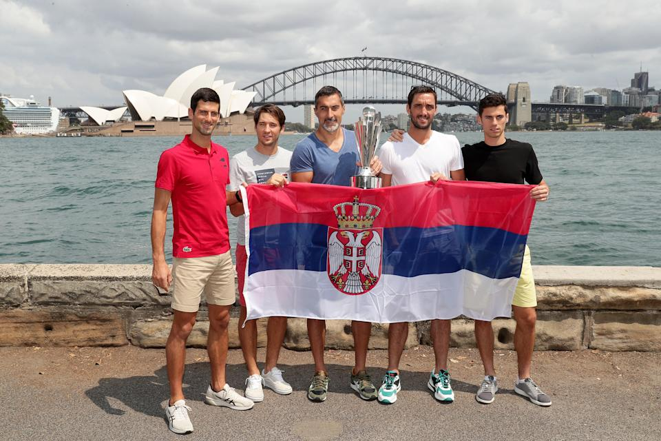 (L-R) Novak Djokovic, Dusan Lajovic, Nenad Zimonjic, Viktor Troicki and Nikola Cacic of Team Serbia pose with the ATP Cup during a media opportunity after winning the 2020 ATP Cup, at Mrs Macquarie's Chair on January 13, 2020 in Sydney, Australia.