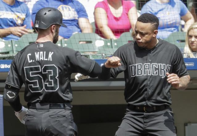 Arizona Diamondbacks' Christian Walker is congratulated after hitting a two-run home run during the first inning of a baseball game against the Milwaukee Brewers Sunday, Aug. 25, 2019, in Milwaukee. (AP Photo/Morry Gash)