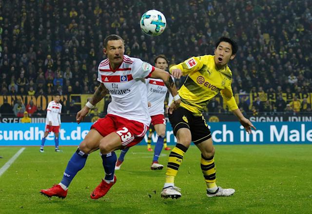 Soccer Football - Bundesliga - Borussia Dortmund vs Hamburger SV - Signal Iduna Park, Dortmund, Germany - February 10, 2018 Hamburg's Sejad Salihovic in action with Borussia Dortmund's Shinji Kagawa REUTERS/Leon Kuegeler DFL RULES TO LIMIT THE ONLINE USAGE DURING MATCH TIME TO 15 PICTURES PER GAME. IMAGE SEQUENCES TO SIMULATE VIDEO IS NOT ALLOWED AT ANY TIME. FOR FURTHER QUERIES PLEASE CONTACT DFL DIRECTLY AT + 49 69 650050