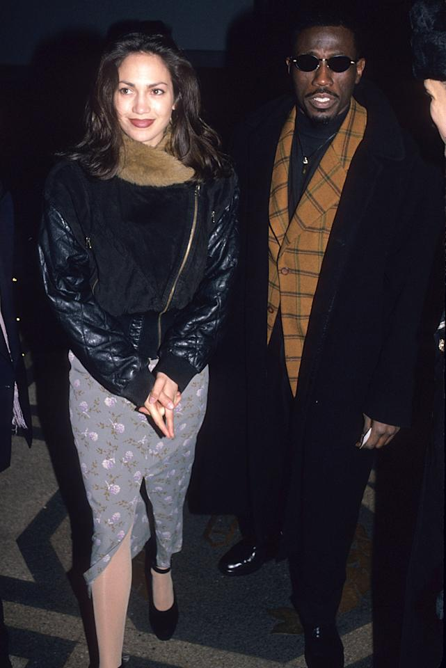 """<p>Even though JLo met the actor Wesley Snipes when filming a sex scene she later publicly called """"horrible,"""" she went on to date Snipes briefly after filming wrapped, this time keeping showcasing a bit more demure '90s fashion.</p>"""