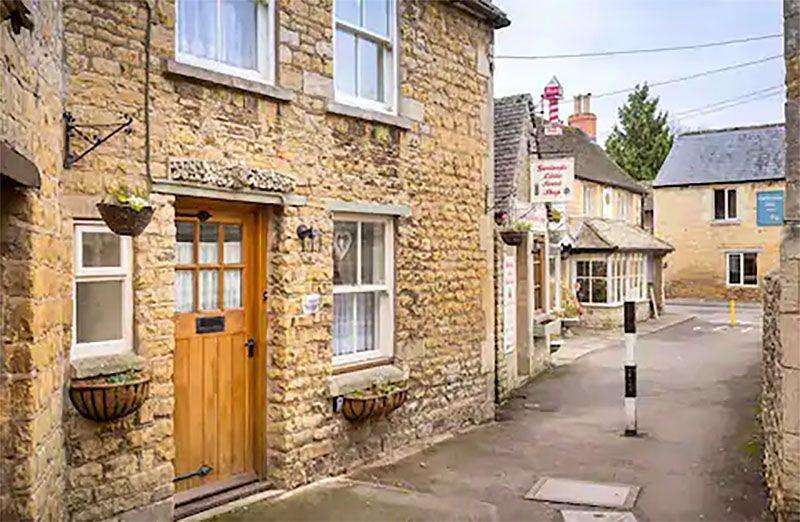 "<p>Known as the Venice of the Cotswolds, Bourton-on-the-Water is one of the most appealing spots in the area. This Airbnb is just the answer if you're after a place with character in the village. Inglenook Cottage is part of a row of stone cottages on a quiet lane in the heart of the village. Expect reclaimed wood floors, a feature fireplace and a typical Cotswold cottage feel.</p><p><strong>Sleeps:</strong> 4</p><p><strong>Price per night:</strong> £172</p><p><a class=""link rapid-noclick-resp"" href=""https://airbnb.pvxt.net/doaney"" rel=""nofollow noopener"" target=""_blank"" data-ylk=""slk:MORE DETAILS"">MORE DETAILS</a></p>"