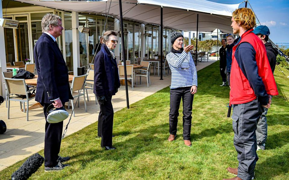 The Princess Royal talks with instructors and students during a visit to the Royal Yacht Squadron at The Castle in Cowes, Isle of Wight - PA