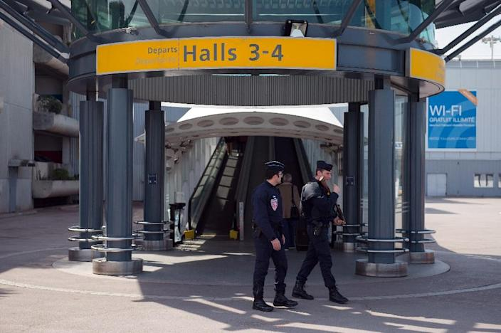 French police officers patrol the Marseille Provence airport in Marignane, on March 22, 2016 (AFP Photo/Betrand Langlois)