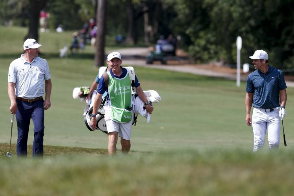 From left to right, Jason Kokrak, caddie John McLaren and Paul Casey share a moment on their way to the green on the 11th hole during the PGA Valspar Championship golf tournament in Palm Harbor, Fla., Friday, April 30, 2021. (Ivy Ceballo/Tampa Bay Times via AP)