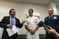 Attorneys Brian Bouffard, left, accompanied by U.S. Navy Lt. Cmdr. Aaron Shephard, and U.S. Air Force Major Jason Cordova, speak with reporters after the second day of an arraignment hearing for their client Malaysian defendant Mohammed Nazir bin Lep, Tuesday, Aug. 31, 2021, in Guantanamo Bay Naval Base, Cuba. Three prisoners at the Guantanamo Bay detention center had their second day in court Tuesday after being held by the U.S. for 18 years without charge in connection with the deadly 2002 Bali nightclub bombings and other plots in Southeast Asia. (AP Photo/Alex Brandon)