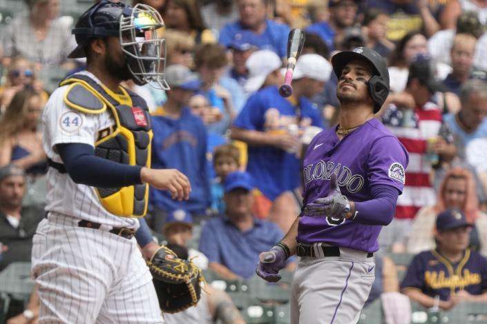 Colorado Rockies' Joshua Fuentes flips his bat after striking out during the second inning of a baseball game against the Milwaukee Brewers Sunday, June 27, 2021, in Milwaukee. (AP Photo/Morry Gash)
