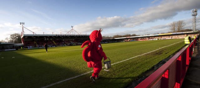 "Crawley Town's mascot ""Reggie the Red"" walks across the pitch ahead of the FA Cup third round against Bristol City at Broadfield Stadium in Crawley on January 7, 2012. Crawley Town won the game 1-0 and advance to the fourth round of the FA cup. AFP PHOTO / ADRIAN DENNIS RESTRICTED TO EDITORIAL USE. No use with unauthorized audio, video, data, fixture lists, club/league logos or ""live"" services. Online in-match use limited to 45 images, no video emulation. No use in betting, games or single club/league/player publications"