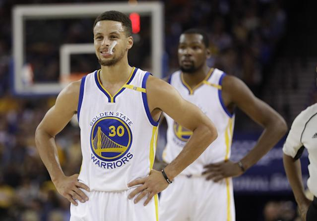 The Warriors have max contracts looming over their shoulder for both Stephen Curry and Kevin Durant. (AP)
