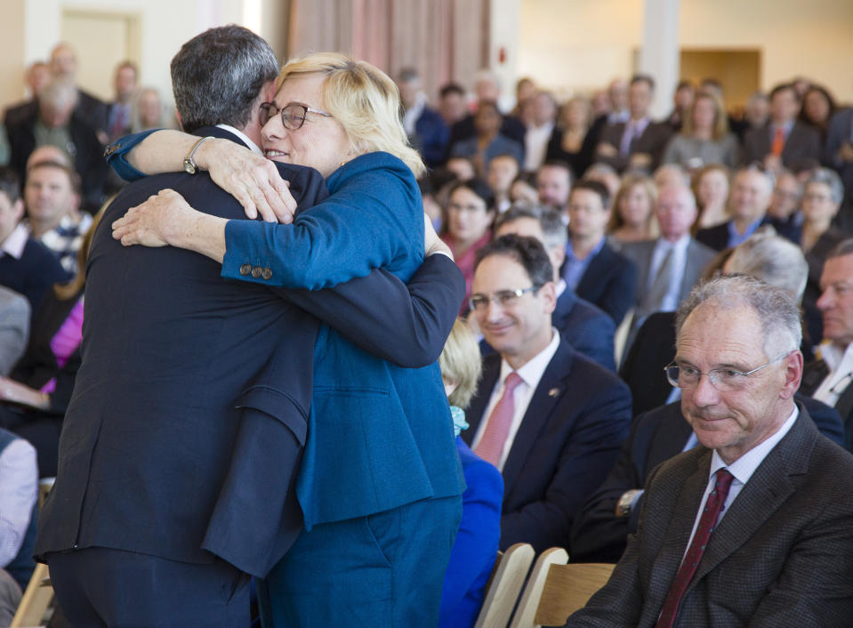 PORTLAND, ME - JANUARY 27: Maine Governor Janet Mills hugs Tilson CEO Josh Broder after he spoke during a press conference at the Portland Ocean Gateway, about Northeastern University's future technology education center in Portland, on Monday, January 27, 2020. Tech entrpreneur David Roux of Lewiston, who is funding the project, looks on at right. (Photo by Carl D. Walsh/Portland Press Herald via Getty Images)