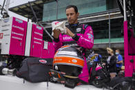 Helio Castroneves of Brazil prepares to drive during practice for the Indianapolis 500 auto race at Indianapolis Motor Speedway in Indianapolis, Tuesday, May 18, 2021. (AP Photo/Michael Conroy)