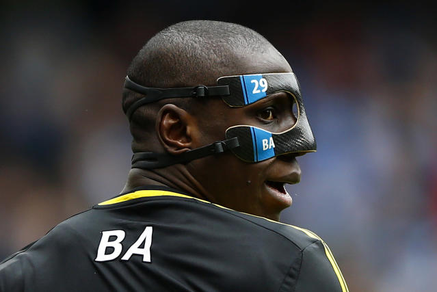 "Chelsea's Demba Ba wears a protective mask during their English Premier League soccer match against Manchester City at The Etihad Stadium in Manchester, northern England, February 24, 2013. REUTERS/Darren Staples (BRITAIN - Tags: SPORT SOCCER TPX IMAGES OF THE DAY) FOR EDITORIAL USE ONLY. NOT FOR SALE FOR MARKETING OR ADVERTISING CAMPAIGNS. NO USE WITH UNAUTHORIZED AUDIO, VIDEO, DATA, FIXTURE LISTS, CLUB/LEAGUE LOGOS OR ""LIVE"" SERVICES. ONLINE IN-MATCH USE LIMITED TO 45 IMAGES, NO VIDEO EMULATION. NO USE IN BETTING, GAMES OR SINGLE CLUB/LEAGUE/PLAYER PUBLICATIONS - RTR3E7FJ"