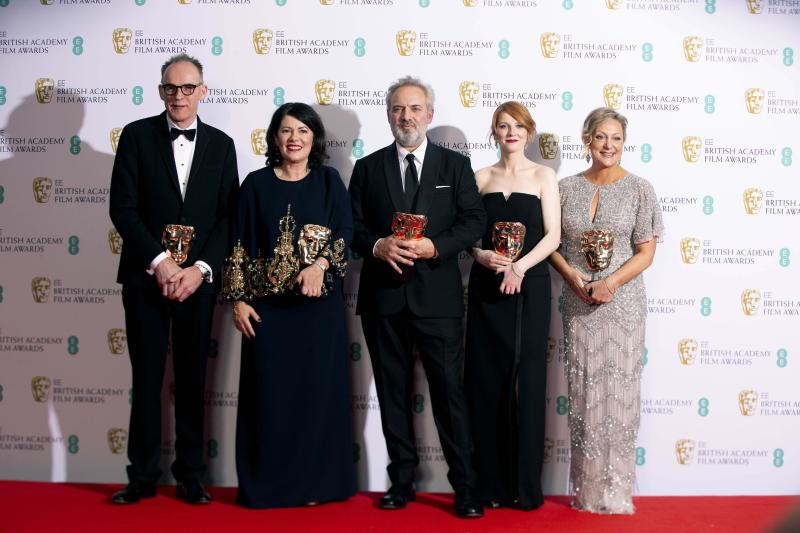 From left, Callum McDougall, Pippa Harris, Sam Mendes, Krysty Wilson-Cairms and Jayne-Anne Tengren, winners of the Outstanding British Film, pose backstage at the Bafta Film Awards, in central London, Sunday, Feb. 2, 2020. (Photo by Joel C Ryan/Invision/AP)