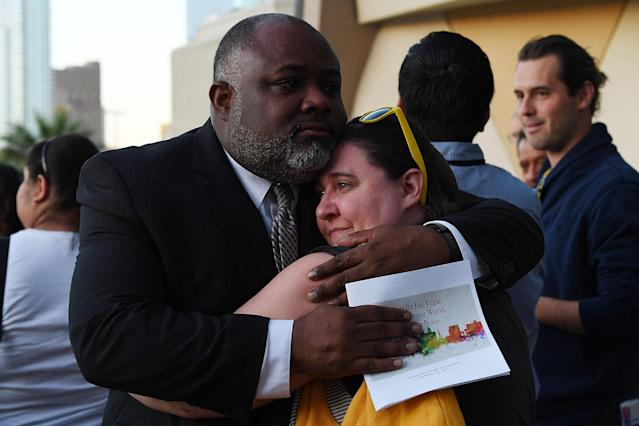 <p>Two people embrace during a vigil at Guardian Angel Cathedral for the victims of the Route 91 Harvest country music festival shootings on October 2, 2017 in Las Vegas, Nevada. (Photo: Denise Truscello/Getty Images) </p>