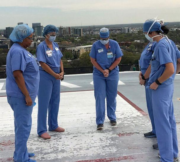 PHOTO: A group of nurses at the Vanderbilt University Medical Center in Nashville pray together on the hospitals helipad. (Courtesy Angela Gleaves)