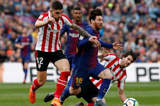 Barcelona took a giant step towards winning the La Liga title after they beat Athletic Bilbao 2-0 on Sunday and nearest challengers Atletico Madrid lost 2-1 at Villarreal, giving the Catalans an 11-point lead at the top of the standings.