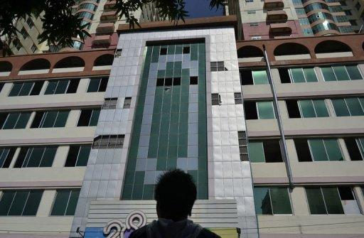 The 25-storey Mann Myanmar Plaza, Mandalay's tallest building, can be seen missing several window panes after a 6.8-magnitude quake struck Myanmar's second-largest city of Mandalay on November 11