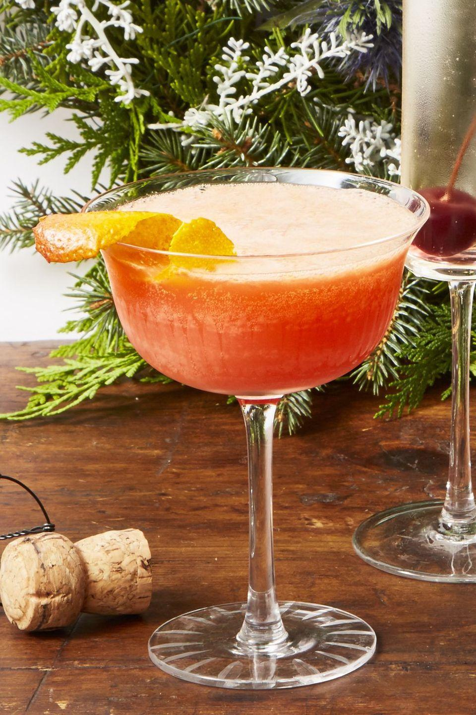 """<p>This light winter twist on the classic Aperol spritz combines champagne, Aperol, and blood orange juice for a festive cocktail that's simple enough to make at any party.</p><p><em><a href=""""https://www.goodhousekeeping.com/food-recipes/party-ideas/a25310897/blood-orange-spritz-recipe/"""" rel=""""nofollow noopener"""" target=""""_blank"""" data-ylk=""""slk:Get the recipe for Blood Orange Spritz »"""" class=""""link rapid-noclick-resp"""">Get the recipe for Blood Orange Spritz »</a></em></p><p><strong>RELATED:</strong> <a href=""""https://www.goodhousekeeping.com/holidays/christmas-ideas/g794/christmas-appetizers/"""" rel=""""nofollow noopener"""" target=""""_blank"""" data-ylk=""""slk:65 Easy Christmas Appetizers To Kick off Your Holiday Feast This Year"""" class=""""link rapid-noclick-resp"""">65 Easy Christmas Appetizers To Kick off Your Holiday Feast This Year</a></p>"""