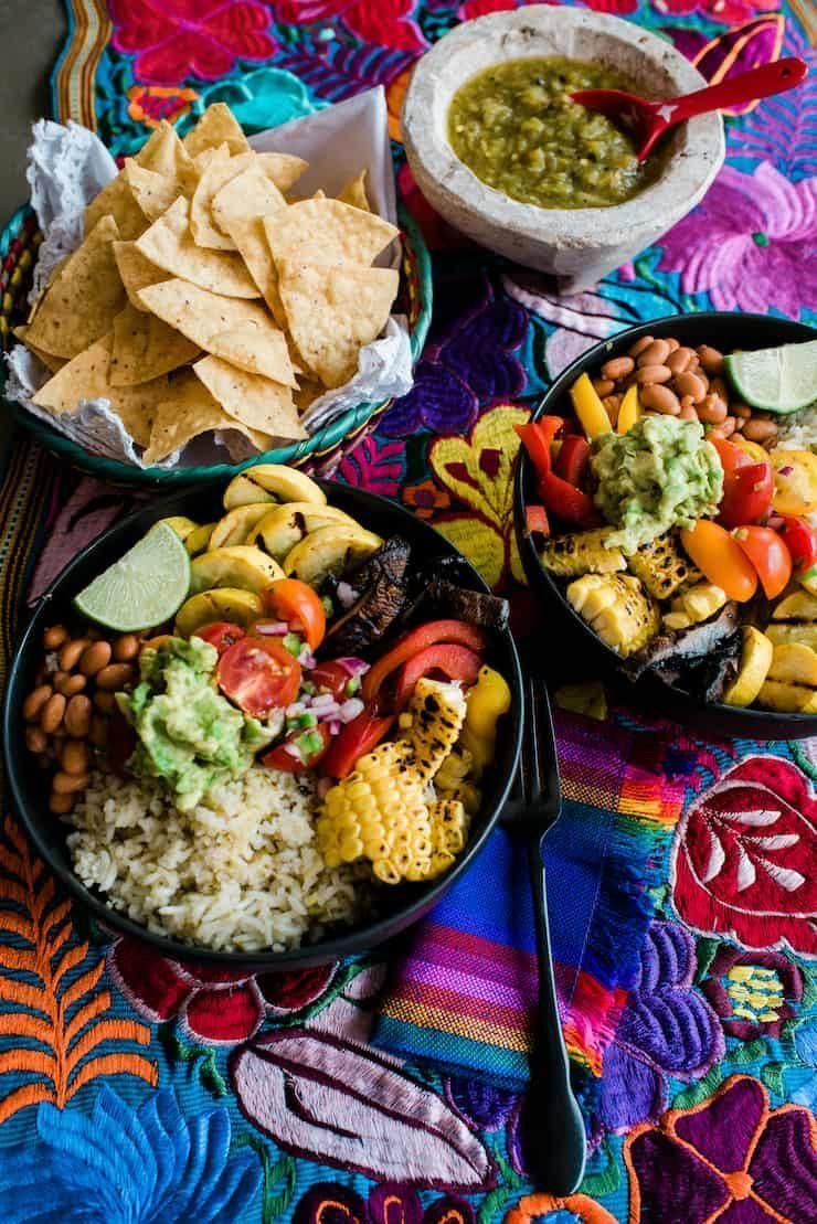 """<p>Skip your weekly Chipotle run and DIY a nutrient-dense vegan burrito bowl filled with fresh or frozen veggies you have on hand, on top of a bed of homemade traditional Mexican rice. Better yet: Build your bowls in bulk and use them as meal prep for the week.</p><p><a class=""""link rapid-noclick-resp"""" href=""""https://muybuenocookbook.com/veggie-burrito-bowls-green-chile-rice/"""" rel=""""nofollow noopener"""" target=""""_blank"""" data-ylk=""""slk:GET THE RECIPE"""">GET THE RECIPE</a></p><p><em>Per serving: 328 calories, 6 g fat (1 g saturated), 776 mg sodium, 62 g carbs, 6 g sugar, 3 g fiber, 8 g protein</em></p>"""