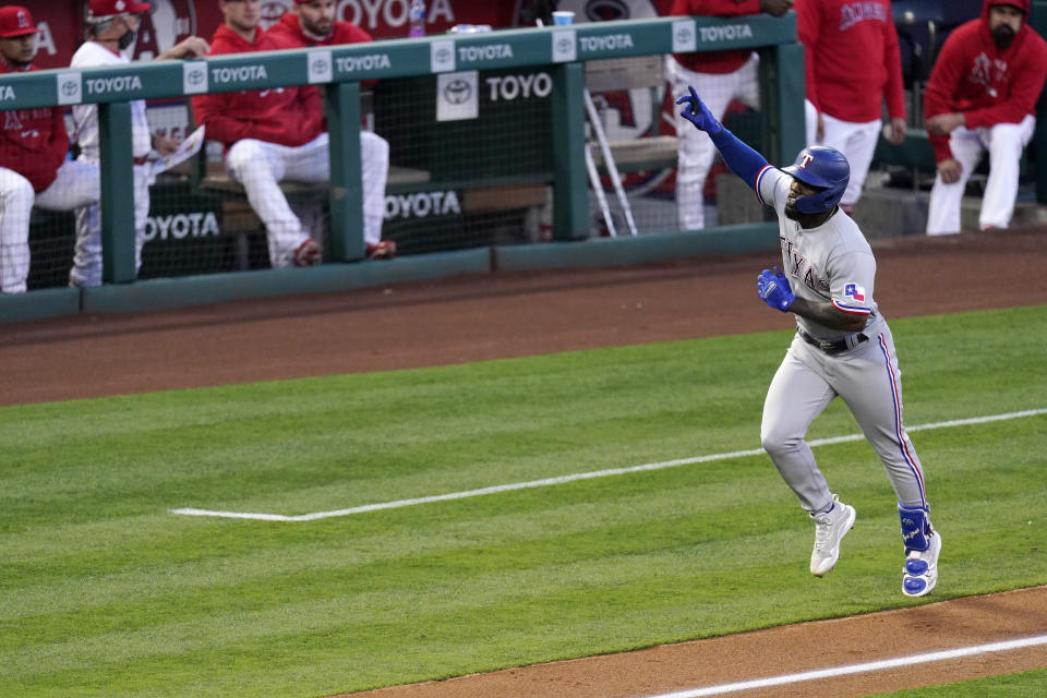 Texas Rangers' Adolis Garcia celebrates as he heads for home after hitting a solo home run during the third inning of a baseball game against the Los Angeles Angels Monday, April 19, 2021, in Anaheim, Calif. (AP Photo/Mark J. Terrill)