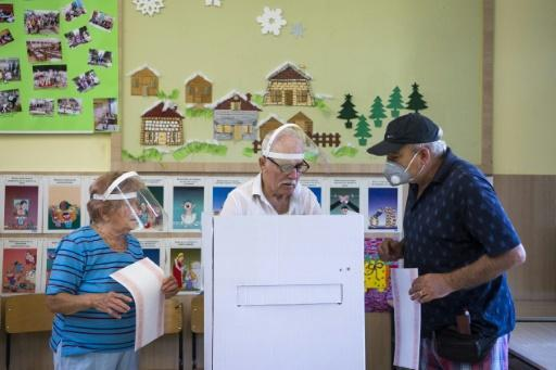 Masks were mandatory at polling stations, which closed later than normal to allow for more social distancing