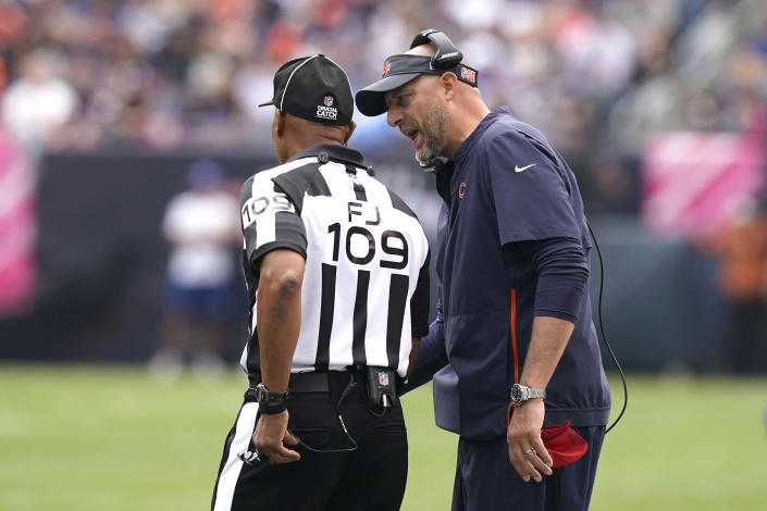 Chicago Bears head coach Matt Nagy talks with an official during the first half of an NFL football game against the Detroit Lions Sunday, Oct. 3, 2021, in Chicago. (AP Photo/Nam Y. Huh)