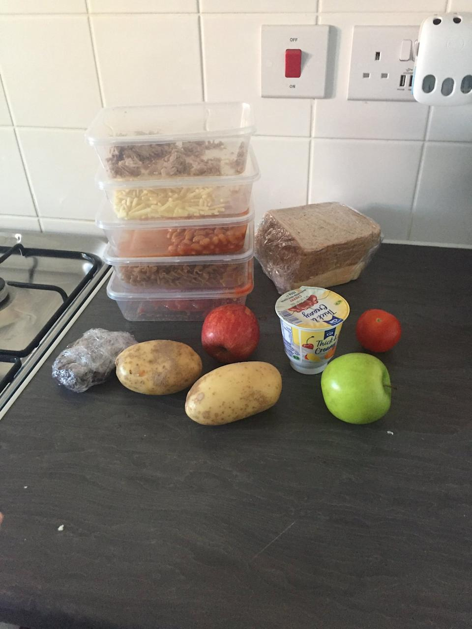 One mum was told how she was forced to throw away the meagre package she got because it contained open fresh food products that weren't refrigerated. (SWNS)